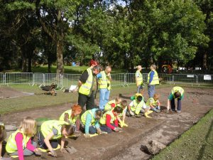 "Schoolchildren ""having a go"" Sept 2011 dig  Photo Ken Shone)"