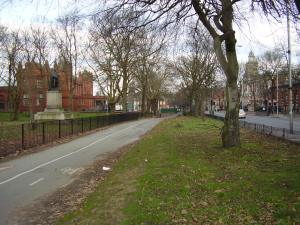 Oxford Rd path, cycleway and isolated grass strip outside new fence. Note that the Main Entrance has gone.